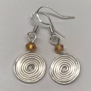 Jewelry - Silver Swirl Earrings Amber Color Bead Accent